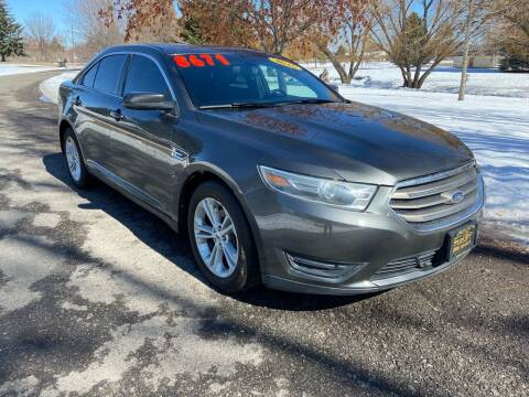 2015 Ford Taurus for sale at BELOW BOOK AUTO SALES in Idaho Falls ID