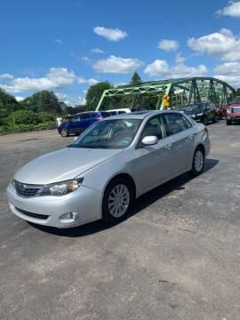 2009 Subaru Impreza for sale at WXM Auto in Cortland NY