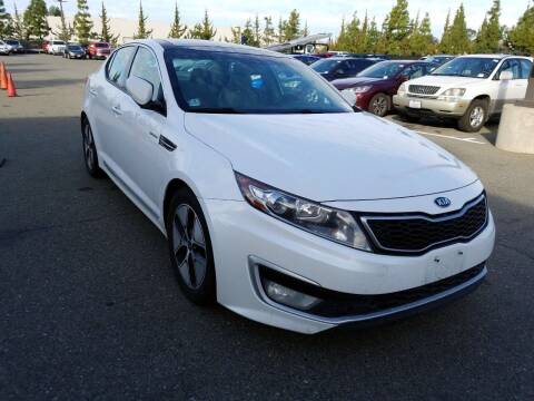 2013 Kia Optima Hybrid for sale at MCHENRY AUTO SALES in Modesto CA
