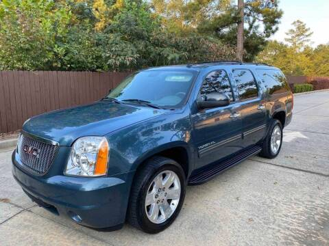 2010 GMC Yukon XL for sale at Two Brothers Auto Sales in Loganville GA
