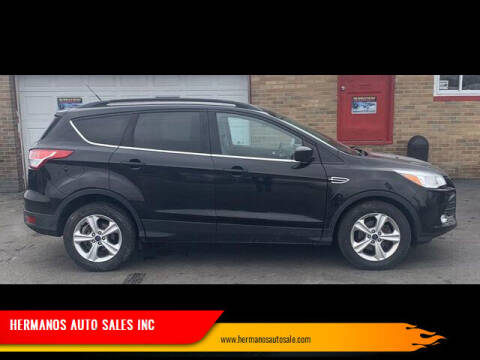2014 Ford Escape for sale at HERMANOS AUTO SALES INC in Hamilton OH