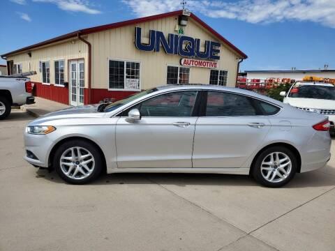 "2014 Ford Fusion for sale at UNIQUE AUTOMOTIVE ""BE UNIQUE"" in Garden City KS"