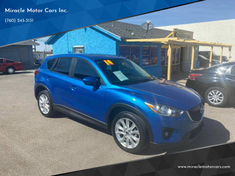 2014 Mazda CX-5 for sale at Miracle Motor Cars Inc. in Victorville CA