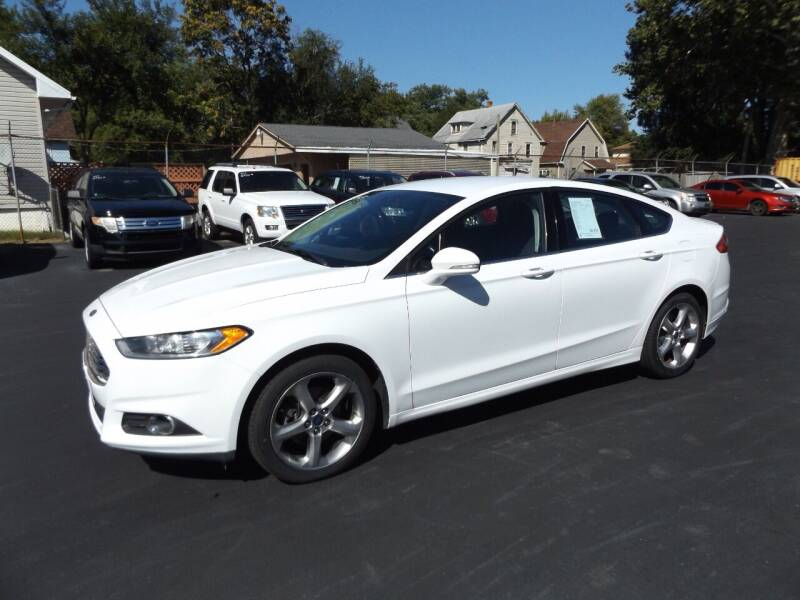 2014 Ford Fusion for sale at Goodman Auto Sales in Lima OH