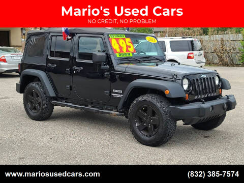 2013 Jeep Wrangler Unlimited for sale at Mario's Used Cars - Pasadena Location in Pasadena TX