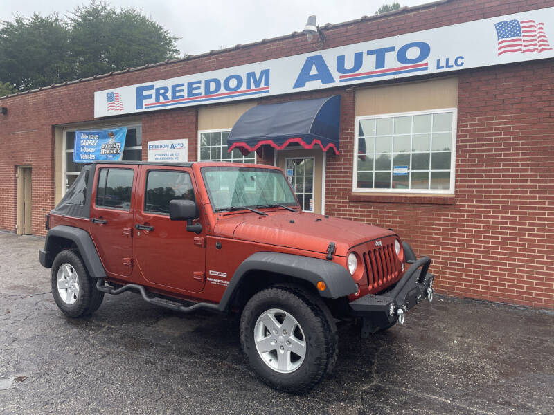 2014 Jeep Wrangler Unlimited for sale at FREEDOM AUTO LLC in Wilkesboro NC
