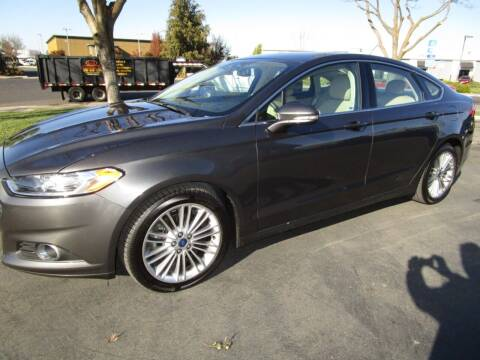 2015 Ford Fusion for sale at KM MOTOR CARS in Modesto CA