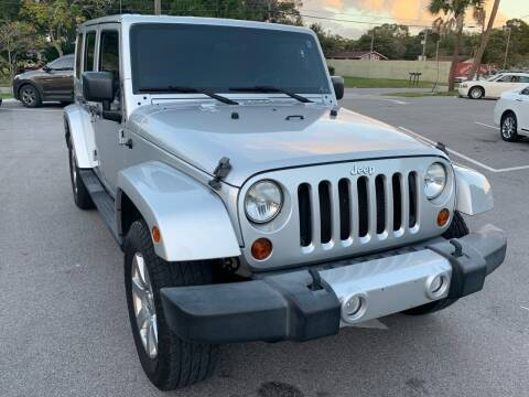 2011 Jeep Wrangler Unlimited for sale at Consumer Auto Credit in Tampa FL