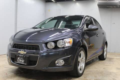 2013 Chevrolet Sonic for sale at Flash Auto Sales in Garland TX