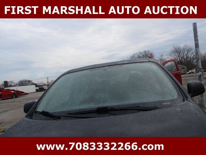 2014 Nissan Versa for sale at First Marshall Auto Auction in Harvey IL