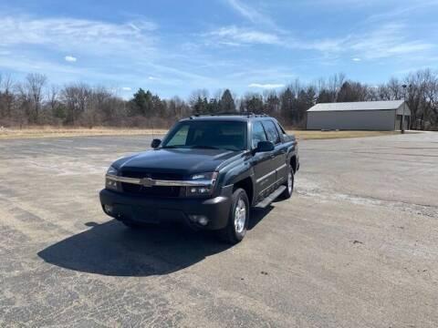 2003 Chevrolet Avalanche for sale at Caruzin Motors in Flint MI