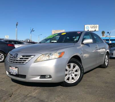 2009 Toyota Camry for sale at LUGO AUTO GROUP in Sacramento CA