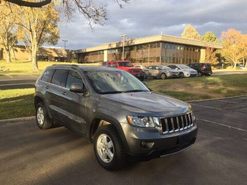 2012 Jeep Grand Cherokee for sale at QUEST MOTORS in Englewood CO
