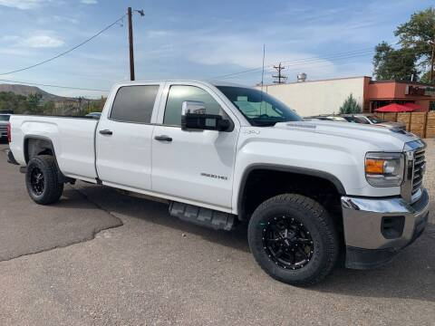 2018 GMC Sierra 2500HD for sale at BERKENKOTTER MOTORS in Brighton CO