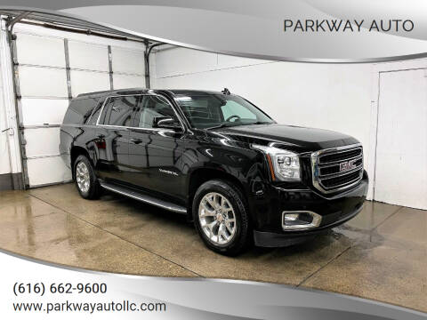 2016 GMC Yukon XL for sale at PARKWAY AUTO in Hudsonville MI