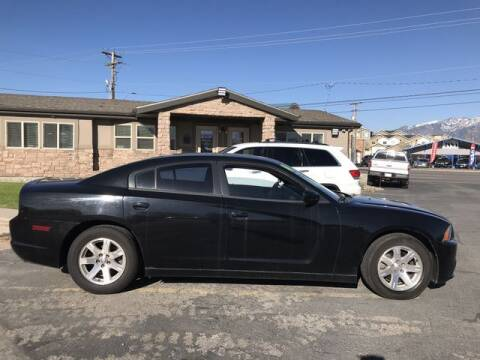 2014 Dodge Charger for sale at INVICTUS MOTOR COMPANY in West Valley City UT