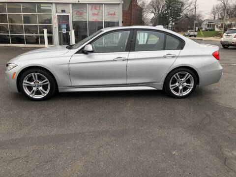 2013 BMW 3 Series for sale at J&J Car and Truck Sales in North Canton OH