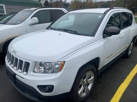 2011 Jeep Compass for sale at BURNWORTH AUTO INC in Windber PA