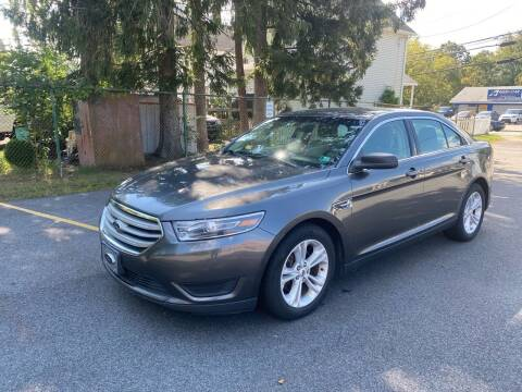 2017 Ford Taurus for sale at AMERI-CAR & TRUCK SALES INC in Haskell NJ