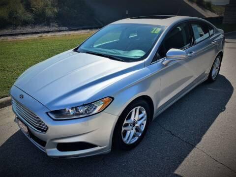 2015 Ford Fusion for sale at Apple Auto in La Crescent MN