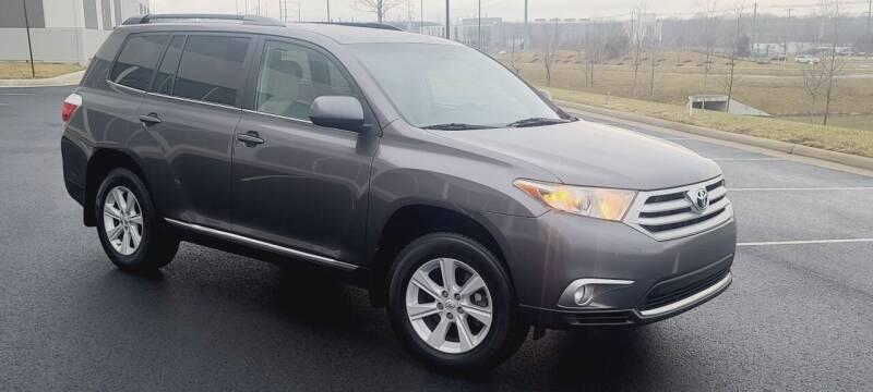 2012 Toyota Highlander for sale at BOOST MOTORS LLC in Sterling VA