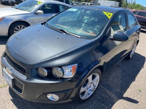 2015 Chevrolet Sonic for sale at CHRISTIAN AUTO SALES in Anoka MN