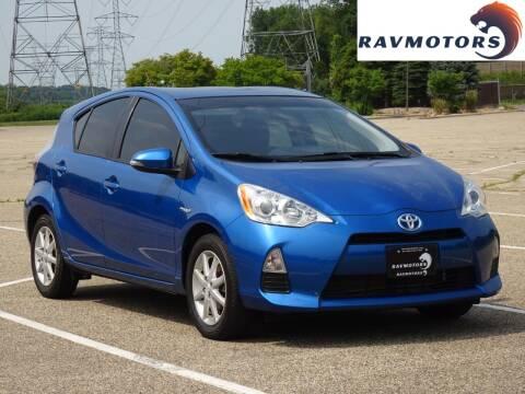 2014 Toyota Prius c for sale at RAVMOTORS in Burnsville MN