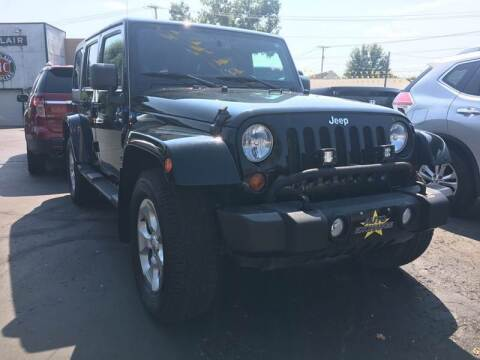 2013 Jeep Wrangler Unlimited for sale at Auto Exchange in The Plains OH