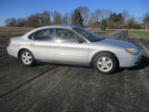 2006 Ford Taurus for sale at Crossroads Used Cars Inc. in Tremont IL