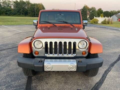 2011 Jeep Wrangler Unlimited for sale at Used Car Factory Sales & Service Troy in Troy OH