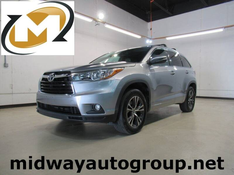 2016 Toyota Highlander for sale at Midway Auto Group in Addison TX
