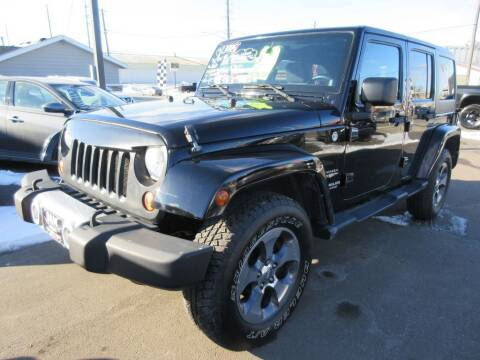 2013 Jeep Wrangler Unlimited for sale at Dam Auto Sales in Sioux City IA