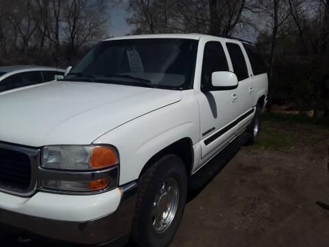 2001 GMC Yukon XL for sale at BARNES AUTO SALES in Mandan ND