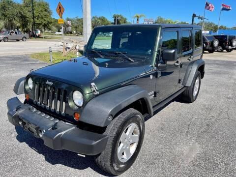 2011 Jeep Wrangler Unlimited for sale at Blum's Auto Mart in Port Orange FL