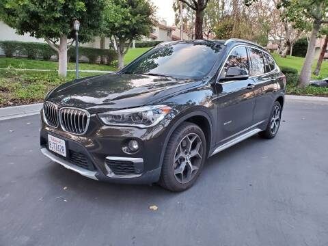 2017 BMW X1 for sale at E MOTORCARS in Fullerton CA