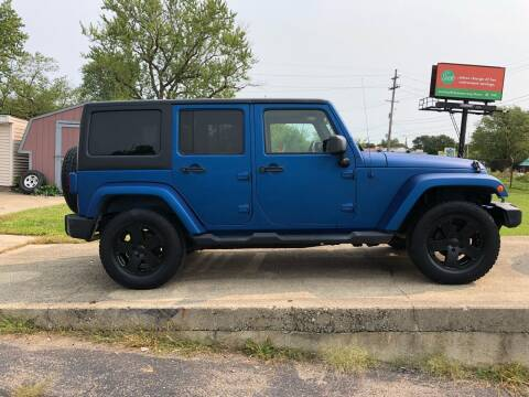 2011 Jeep Wrangler Unlimited for sale at Dean's Auto Sales in Flint MI