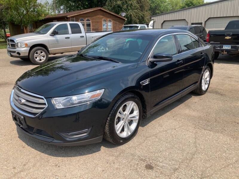 2014 Ford Taurus for sale at COUNTRYSIDE AUTO INC in Austin MN