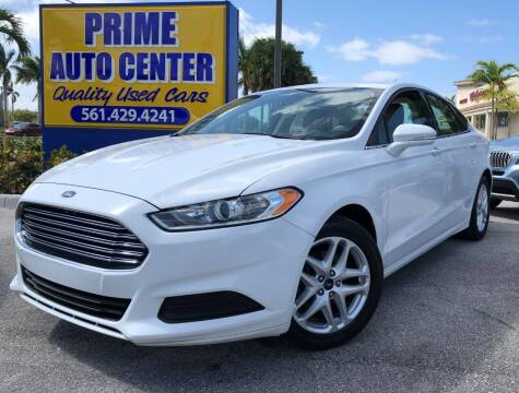 2014 Ford Fusion for sale at PRIME AUTO CENTER in Palm Springs FL