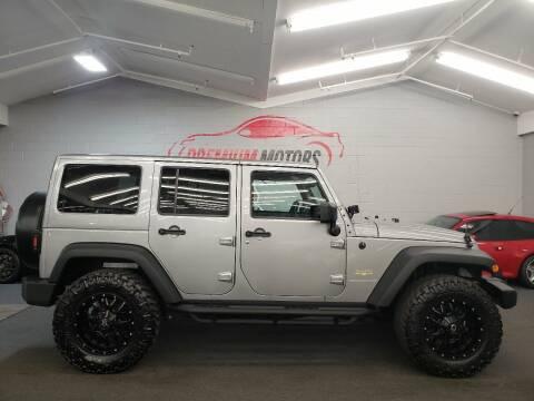 2013 Jeep Wrangler Unlimited for sale at Premium Motors in Villa Park IL