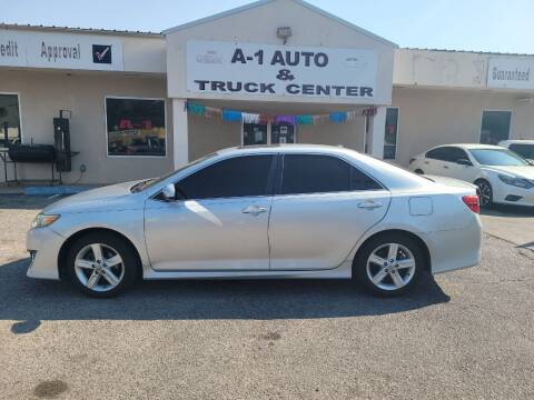 2014 Toyota Camry for sale at A-1 AUTO AND TRUCK CENTER in Memphis TN