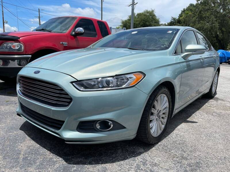 2013 Ford Fusion Hybrid for sale at Always Approved Autos in Tampa FL