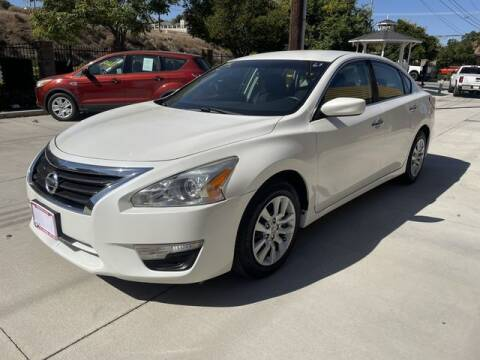 2014 Nissan Altima for sale at Los Compadres Auto Sales in Riverside CA