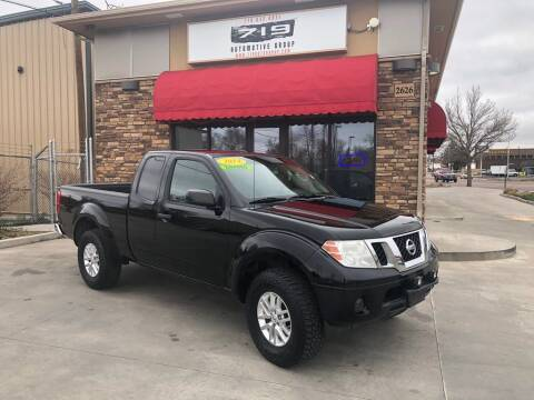 2014 Nissan Frontier for sale at 719 Automotive Group in Colorado Springs CO