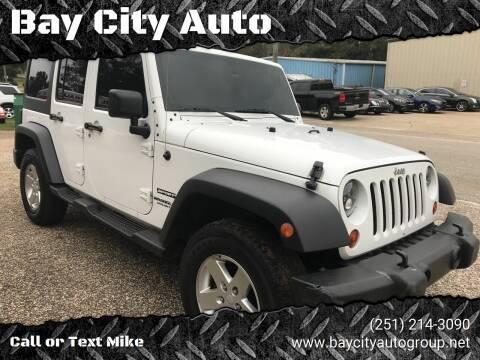 2013 Jeep Wrangler Unlimited for sale at Bay City Auto's in Mobile AL