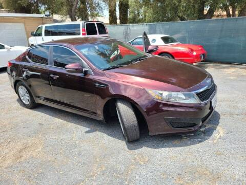 2011 Kia Optima for sale at E and M Auto Sales in Bloomington CA