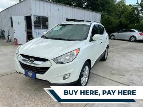 2012 Hyundai Tucson for sale at H3 MOTORS in Dickinson TX