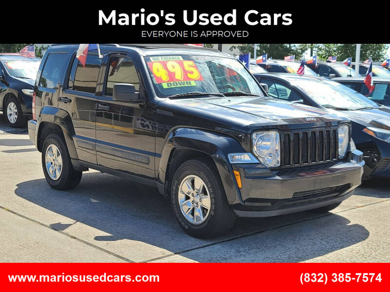 2011 Jeep Liberty for sale at Mario's Used Cars in Houston TX