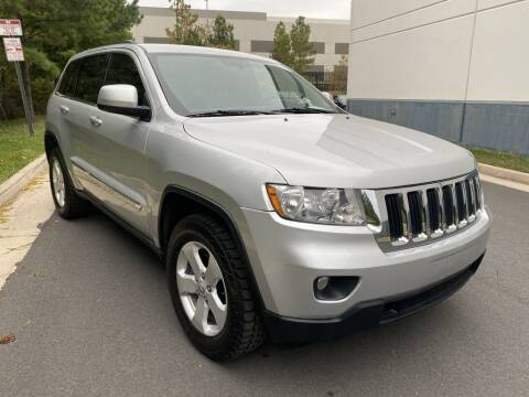 2013 Jeep Grand Cherokee for sale at PM Auto Group LLC in Chantilly VA