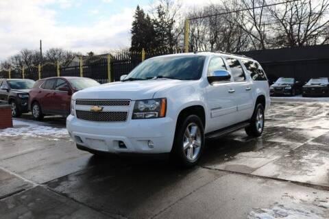 2011 Chevrolet Suburban for sale at F & M AUTO SALES in Detroit MI