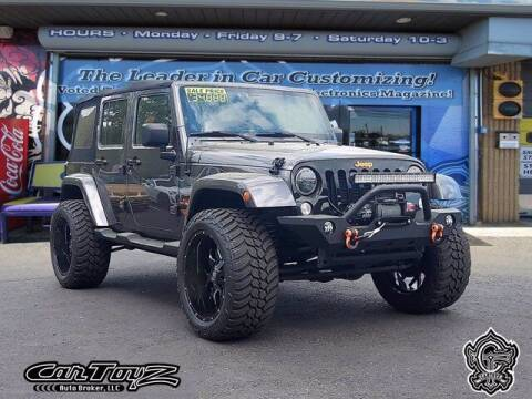 2014 Jeep Wrangler Unlimited for sale at Distinctive Car Toyz in Pleasantville NJ